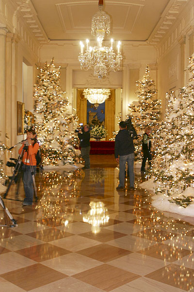 the press viewing the christmas decorations in the grand foyer of the white house the