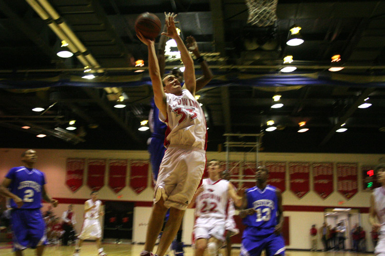 Mills E. Godwin High School junior Fletcher Lumpkin (22) goes up high for