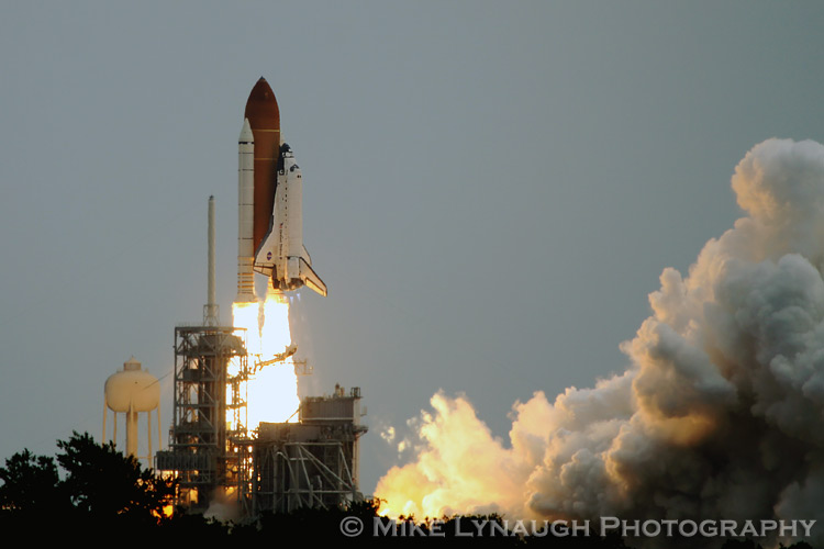 Space Shuttle Atlantis roars off of the launch pad as she ...