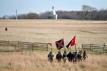 "North Carolina reenactors retrace the steps the soldiers they are portraying took during the charge that has become known as ""Pickett's Charge"" on that fateful day on this exact land 145 years ago during Remembrance Day in Gettysburg, PA.  © Mike Lynaugh"
